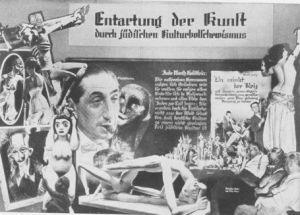 """Affiche de l'exposition """"Entartung der Kunst durch Jüdilehen Kulturbolchewismus"""" (Dégénération de l'art par la culture bolchéviques des juifs), Nuremberg, 1937, montrant un photomontage où apparaît Flechtheim, fumant un cigare, entouré de diverses peintures et sculptures…"""