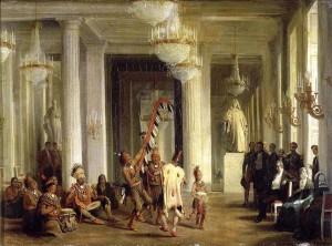 Karl Girardet (1813-1871), « Le roi Louis-Philippe assiste à une danse d'Indiens Iowas ». Le roi Louis-Philippe, la reine Marie-Amélie et la duchesse d'Orléans assistant, dans le salon de la Paix, aux Tuileries, à une danse d'Indiens Iowas que leur présente le peintre George Catlin, le 21 avril 1845. Huile sur toile, 1846. H. : 39 cm, L. : 54 cm. Musée national du château de Versailles. Inv. MV6138. © RMN-Grand Palais 91-000581.